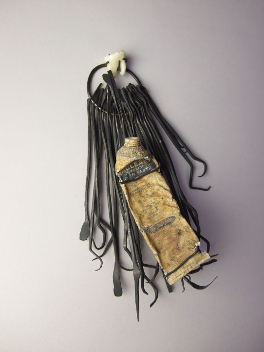 Lucy Harvey - Tooth Amulet. Toothpaste tube, tooth, oxidized copper.